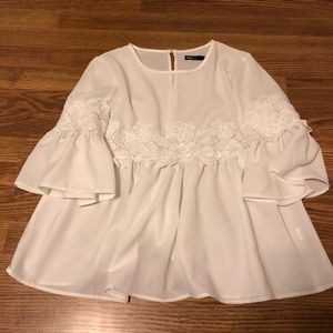 white blouse with floral detail